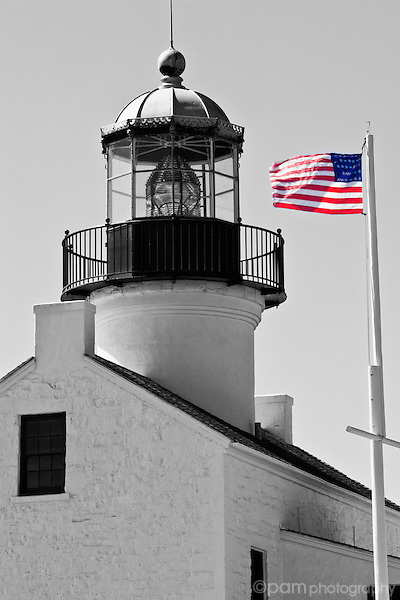 Light house with flag at Point Loma, California
