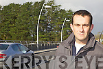 LIGHT UP: Listowel town councillor, Jimmy Moloney who is asking why new lights on Listowel Bridge are still not working.