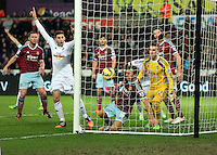 Pictured: Angel Rangel celebrating the equaliser scored by team mate Bafetimbi Gomis of Swansea Saturday 10 January 2015<br />