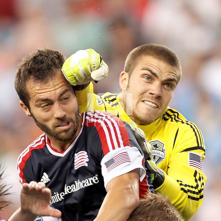 Seattle Sounders FC goalkeeper Andrew Weber (33) punches ball away from New England Revolution defender AJ Soares (5). In a Major League Soccer (MLS) match, the New England Revolution tied the Seattle Sounders FC, 2-2, at Gillette Stadium on June 30, 2012.