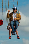Jamie Oliver having a go on the wave swinger at the Big Feastival 2017, aton Alex James' farm Kingham Oxfordshire uk