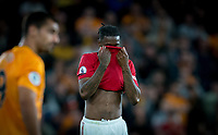 Aaron Wan-Bissaka of Man Utd covers his face during the Premier League match between Wolverhampton Wanderers and Manchester United at Molineux, Wolverhampton, England on 19 August 2019. Photo by Andy Rowland.