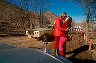 Wasco, Oregon, January 1984: Disciples of Bhagwan Rajneesh express openly their mutual love to one another in front of a Rolls-Roys car. Bhawan Rajneesh (now known as Osho) possessed more than 20 Rolls-Royce cars and never used the same car two days in a row.  Rajneeshpuram, was an intentional community in Wasco County, Oregon, briefly incorporated as a city in the 1980s, which was populated with followers of the spiritual teacher Osho, then known as Bhagwan Shree Rajneesh. The community was developed by turning a ranch from an empty rural property into a city complete with typical urban infrastructure, with population of about 7000 followers.