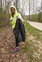 NWA Democrat-Gazette/FLIP PUTTHOFF <br /> PICKING UP AT CLEANUP<br /> Anna McDonald, 9, picks up litter along a trail Saturday April 21 2018 during a cleanup day at Lake Atalanta Park near downtown Rogers. She was at the cleanup with her dad, Lucas McDonald. Individuals, families and organizations took part in the event working in all areas of the park and along the shoreline of Lake Atalanta. The city of Rogers, Ozark Water Watch, Benton County Extension Office and Downtown Rogers Rotary Club organized the cleanup.