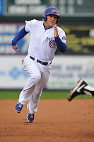 Chris Valaika #4 of the Iowa Cubs runs to third base against the Omaha Storm Chasers at Principal Park on May 1, 2014 in Des Moines, Iowa. The Cubs  beat Storm Chasers 1-0.   (Dennis Hubbard/Four Seam Images)