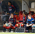 Declan John with ice pack and Bruno Alves on bench