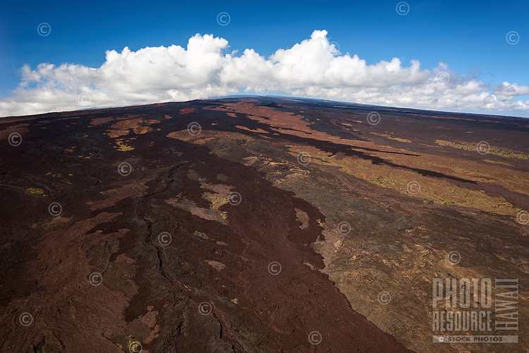 An aerial view of the old lava flows down the face of Mauna Loa, Big Island of Hawai'i.