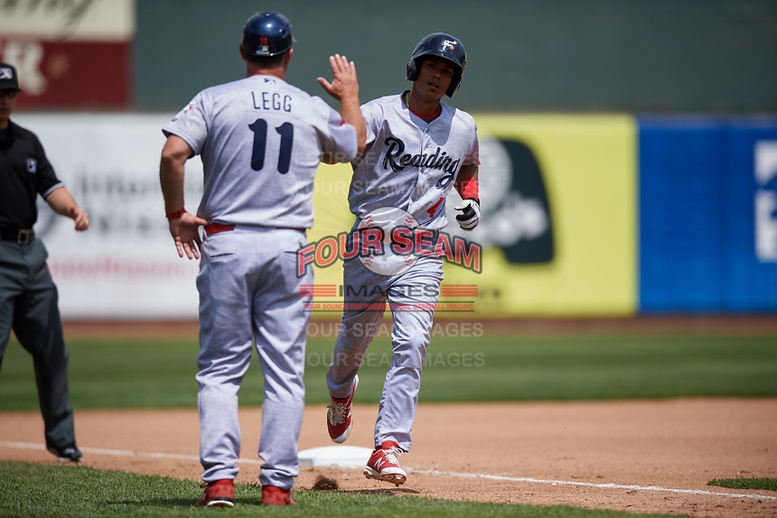 Reading Fightin Phils designated hitter Osmel Aguila (4) is congratulated by manager Greg Legg (11) as he rounds third base after hitting a home run in the top of the fourth inning during a game against the Erie SeaWolves on May 18, 2017 at UPMC Park in Erie, Pennsylvania.  Reading defeated Erie 8-3.  (Mike Janes/Four Seam Images)