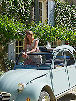 Jemima French in a Citroen 2CV parked in front of her country house in Bergerac