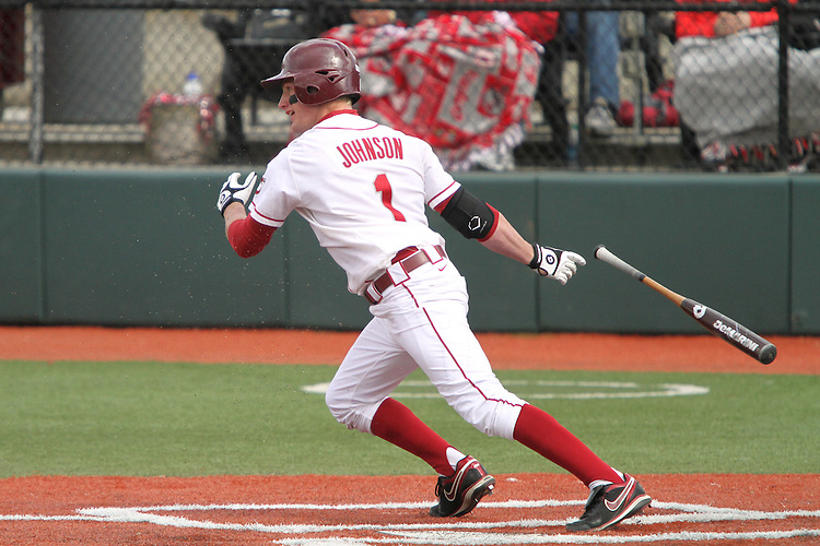 Kyle Johnson (#1), Washington State outfielder, stirs up the ground up rubber tires in the field turf at home plate after connecting on a pitch during the Cougars Pac-10 conference baseball game with Oregon State at Bailey-Brayton Field on the  WSU campus in Pullman, Washington, on April 24, 2010.
