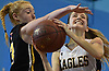 Delilah Doyle #22 of West Babylon, right, shoots under pressure from Megan Lucey #12 of Wantagh during a non-league girls basketball game at Robert Moses Middle School in North Babylon on Saturday, Dec. 22, 2018. Wantagh won by a score of 49-30.