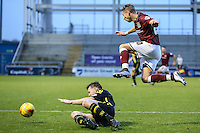 Lee Martin of Northampton Town (right) hurdels Adam Dugdale of Morecambe (left) during the Sky Bet League 2 match between Northampton Town and Morecambe at Sixfields Stadium, Northampton, England on 23 January 2016. Photo by David Horn / PRiME Media Images.