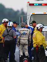 Jun 2, 2018; Joliet, IL, USA; NHRA funny car driver John Force is escorted to an ambulance by the Safety Safari rescue team after crashing into the wall during qualifying for the Route 66 Nationals at Route 66 Raceway. Mandatory Credit: Mark J. Rebilas-USA TODAY Sports