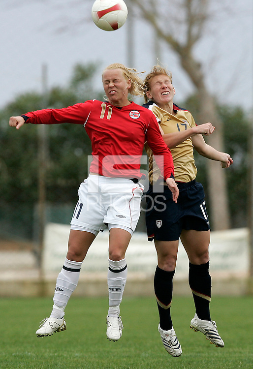 USA´s Lori Chalupny fights for the ball with Norway´s Leni Kaurin. The United States defeated Norway 4-0 during an Algarve Cup Group B match at Restinga Stadium in Alvor, Portugal on March 10, 2008. Paulo Cordeiro/isiphotos.com