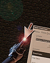 A photo-illustration depicting a force-sensitive glove controlling a computer mouse cursor.