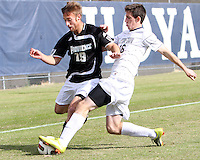 Jimmy Nealis #16 of Georgetown University gets the ball from Daniel Fabian #19 of Providence University during a Big East quarter-final  match at North Kehoe Field, Georgetown University on November 6 2010 in Washington D.C. Providence won 2-1.