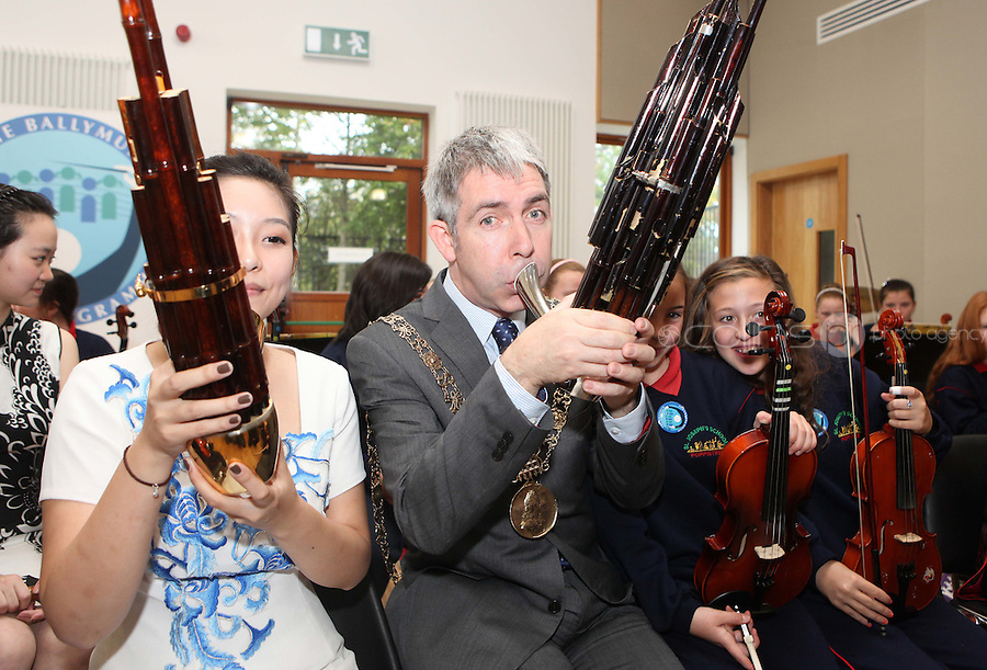 09/09/2011.Lord Mayor of dublin Andrew Montague & Chineese musican  Fang Yuan in traditional Chinese costume during a vist by the musicans to  St Joseph's Senior School, Ballymun, Dublin marking the official Irish visit of the Lord Mayor of Beijing, taking place this weekend.Photo: Collins