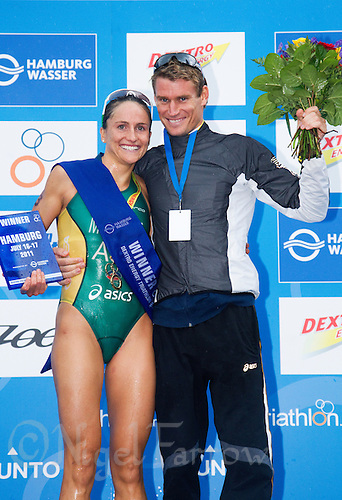 17 JUL 2011 - HAMBURG, GER - Emma Moffatt (AUS) and her coach and partner Brad Kahlefeldt (AUS) celebrate their wins after the  Hamburg round of triathlon's ITU World Championship Series .(PHOTO (C) NIGEL FARROW)