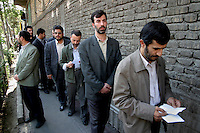 Tehran mayor Mahmoud Ahmadinejad waits in a queue of voters to cast his vote during the 2005 presidential elections in Iran. The relative unknown made a strong showing in the first round and was eventually elected president.