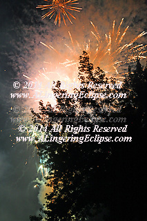 Rhinelander, WI celebrates the 4th of July at Hodag Park on Boom Lake where the boats arrive to watch from the water, and all ages wait in their lawn chairs for another year's celebration.