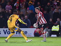 Lincoln City's Matt Rhead vies for possession with Northampton Town's Hakeem Odoffin<br /> <br /> Photographer Andrew Vaughan/CameraSport<br /> <br /> Emirates FA Cup First Round - Lincoln City v Northampton Town - Saturday 10th November 2018 - Sincil Bank - Lincoln<br />  <br /> World Copyright &copy; 2018 CameraSport. All rights reserved. 43 Linden Ave. Countesthorpe. Leicester. England. LE8 5PG - Tel: +44 (0) 116 277 4147 - admin@camerasport.com - www.camerasport.com