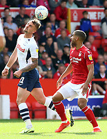 Preston North End's Patrick Bauer heads away from Nottingham Forest's Lewis Grabban<br /> <br /> Photographer David Shipman/CameraSport<br /> <br /> The EFL Sky Bet Championship - Nottingham Forest v Preston North End - Saturday 31st August 2019 - The City Ground - Nottingham<br /> <br /> World Copyright © 2019 CameraSport. All rights reserved. 43 Linden Ave. Countesthorpe. Leicester. England. LE8 5PG - Tel: +44 (0) 116 277 4147 - admin@camerasport.com - www.camerasport.com