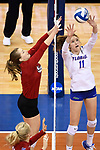 KANSAS CITY, MO - DECEMBER 16: Cheyenne Huskey (11) of the University of Florida sets the ball during the Division I Women's Volleyball Championship held at Sprint Center on December 16, 2017 in Kansas City, Missouri. (Photo by Jamie Schwaberow/NCAA Photos via Getty Images)