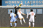 18 October 2013: North Carolina's Brendan Moore (left) catches the ball over Syracuse's Emil Ekblom (NOR) (14). The University of North Carolina Tar Heels hosted the Syracuse University Orangemen at Fetzer Field in Chapel Hill, NC in a 2013 NCAA Division I Men's Soccer match. UNC won the game 1-0.