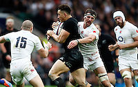Photo: Richard Lane/Richard Lane Photography. England v New Zealand. QBE Autumn International. 08/11/2014. New Zealand's Sonny Bill Williams is tackled by England's Tom Wood.