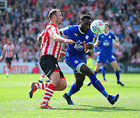 Lincoln City's Matt Rhead battles with Tranmere Rovers' Emmanuel Monthe<br /> <br /> Photographer Andrew Vaughan/CameraSport<br /> <br /> The EFL Sky Bet League Two - Lincoln City v Tranmere Rovers - Monday 22nd April 2019 - Sincil Bank - Lincoln<br /> <br /> World Copyright © 2019 CameraSport. All rights reserved. 43 Linden Ave. Countesthorpe. Leicester. England. LE8 5PG - Tel: +44 (0) 116 277 4147 - admin@camerasport.com - www.camerasport.com