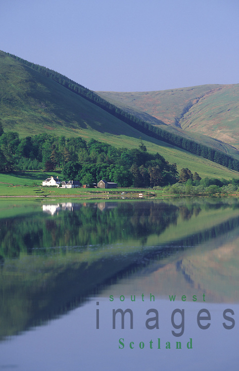 Loch of the Lowes at St Marys Loch looking down to Riskinhope farm surrounded by hills in the Scottish Borders Scotland UK