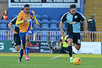 Wycombe Wanderers Sam Wood breaks forward tracked by Mansfield Town's Reggie Lambe during the Sky Bet League 2 match between Mansfield Town and Wycombe Wanderers at the One Call Stadium, Mansfield, England on 31 October 2015. Photo by Garry Griffiths.