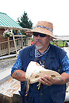 Alaska, Cruising the Southeast wilderness waterways on the Spirit of Discovery. Visit to Tlingit native village of Kake, population 800.  Photos of clothing design, totem pole, wood carver, world?s tallest totem pole at 132 feet, dances, male dancer (model released) and houses..Photo #: alaska10656 .Photo copyright Lee Foster, 510/549-2202, lee@fostertravel.com, www.fostertravel.com.