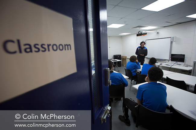 Former professional footballer and convicted drug dealer Michael Kinsella, pictured with students in a classroom at Prenton Park, home of Tranmere Rovers FC, where he works for the club's football development programme. Kinsella, a former player at Liverpool and Rovers, served four separate gaol terms before devising and starting a programme for young people to combine apprenticeships and football. Michael started working with Tranmere Rovers in September 2015 when 25 youngsters were selected for entry onto what was then called the TRFC Scholarship programme.