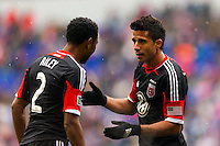 Marcelo Saragosa (11) of D. C. United talks with James Riley (2). The New York Red Bulls and D. C. United played to a 0-0 tie during a Major League Soccer (MLS) match at Red Bull Arena in Harrison, NJ, on March 16, 2013.