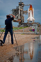 Space shuttle Atlantis reflects in rain puddle before final launch, Kennedy Space Center, Cape Canaveral, Florida, USA, July 7, 2011. Photo by Debi Pittman Wilkey