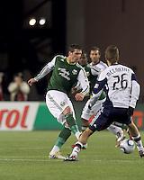 Portland Timbers forward Kenny Cooper (33) passes the ball. In a Major League Soccer (MLS) match, the New England Revolution tied the Portland Timbers, 1-1, at Gillette Stadium on April 2, 2011.