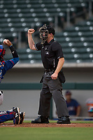 Home plate umpire Austin Nelson calls a strike during an Arizona League game between the AZL Rangers and the AZL Cubs 2 at Sloan Park on July 7, 2018 in Mesa, Arizona. AZL Rangers defeated AZL Cubs 2 11-2. (Zachary Lucy/Four Seam Images)