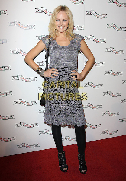 MALIN AKERMAN .Odd Molly Flagship Store Opening held At Odd Molly Boutique, Beverly Hills, California, USA, 19th March 2010..full length grey gray lace crochet dress bracelets black shoulder bag leggings peep open toe shoes sandals cage cut out hands on hips .CAP/ADM/KB.©Kevan Brooks/AdMedia/Capital Pictures.