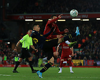 30th October 2019; Anfield, Liverpool, Merseyside, England; English Football League Cup, Carabao Cup, Liverpool versus Arsenal; Ainsley Maitland-Niles of Arsenal makes a clearance under pressure from Adam Lallana of Liverpool - Strictly Editorial Use Only. No use with unauthorized audio, video, data, fixture lists, club/league logos or 'live' services. Online in-match use limited to 120 images, no video emulation. No use in betting, games or single club/league/player publications