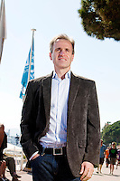 Bruce McColl, Chief Marketing Officer of Mars, poses for the photographer on Cannes seafront, France, 21 June 2012. <br />
