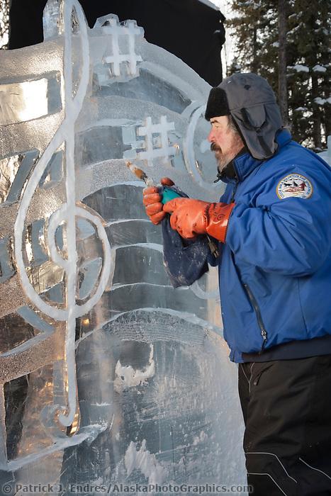 "Jim Warner, USA, works on the multi block sculpture titled ""Irish Wedding"" for the 2009 World Ice Art Championships in Fairbanks, Alaska. Team members: Mark Chapin, Mimi Chapin, Jim Warner, Pat Moodie"