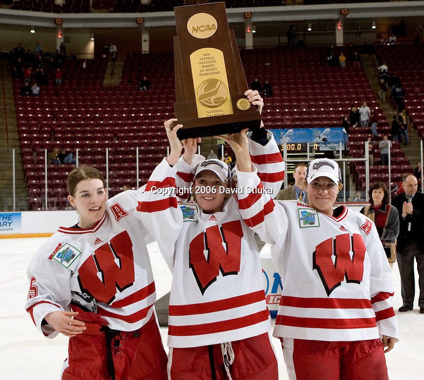 MINNEAPOLIS, MN - MARCH 26: Captains (from left to right) Sara Bauer #15, Sharon Cole #11 and Nikki Burish #14 of the Wisconsin Badgers women's hockey team show off the National Championship trophy after beating the Minnesota Golden Gophers at Mariucci Arena during the Women's Frozen Four Tournament final on March 26, 2006 in Minneapolis, Minnesota. The Badgers beat the Gophers 3-0. (Photo by David Stluka)