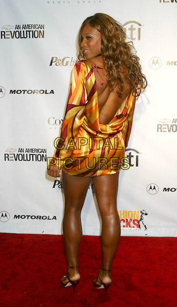 SERENA WILLIAMS.Conde' Nast Media Group Presents Fashion Rocks 2004   Radio City Music Hall in New York City..September 8, 2004 .full length, backless, back, behind, rear, looking over shoulder.www.capitalpictures.com.sales@capitalpictures.com.© Capital Pictures