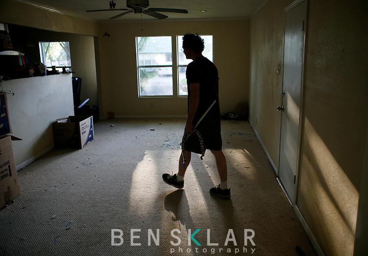 Jeff walks through their empty house in Austin.