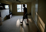 Jeff walks through their empty house in Austin.