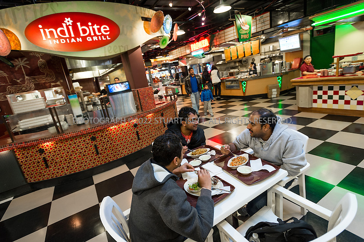 2/9/2013--Bellevue, WA, USA..The food court at Crossroads Mall. Crossroads, the coziest little shopping mall in the West and an aptly named community center for what may be the Eastside's most ethnically diverse neighborhood. That diversity is both visible and audible at Crossroads.  At its international food court, you don't just sample dishes from faraway places. You hear the next tables speaking the languages that go with them. ..©2013 Stuart Isett. All rights reserved.