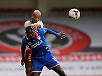 Alex Baptiste of Sheffield Utd gets above Jonathan Forte of Oldham Athletic during the Sky Bet League One match at The Bramall Lane Stadium.  Photo credit should read: Simon Bellis/Sportimage