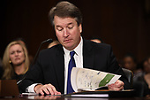 Supreme Court nominee Judge Brett Kavanaugh looks at documents, including his 1982 agenda, as he testifies before the US Senate Judiciary Committee on Capitol Hill in Washington, DC, September 27, 2018. <br /> Kavanaugh was to testify in front of the panel next on Thursday afternoon, having stridently rejected the allegations of sexual abuse by Blasey Ford and two other women in prepared remarks. / POOL / SAUL LOEB