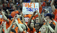 Virginia  fans hold up signs during the second half of an NCAA basketball game Saturday Jan. 18, 2014 in Charlottesville, VA. Virginia defeated Florida State 78-66. (AP Photo/Andrew Shurtleff)